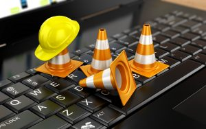 construction warning cones on laptop keyboard